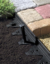 Landscape Fabric And Grassy Pavers In Edmonton Cascade